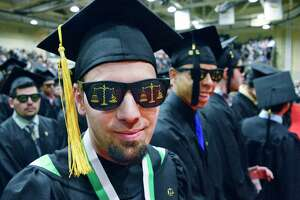 Hudson Valley Community College criminal justice graduate Brandon Ambrosino of Fonda sports a pair of Scales of Justice shades during Commencement Saturday May 12, 2018 in Troy, NY.  (John Carl D'Annibale/Times Union)