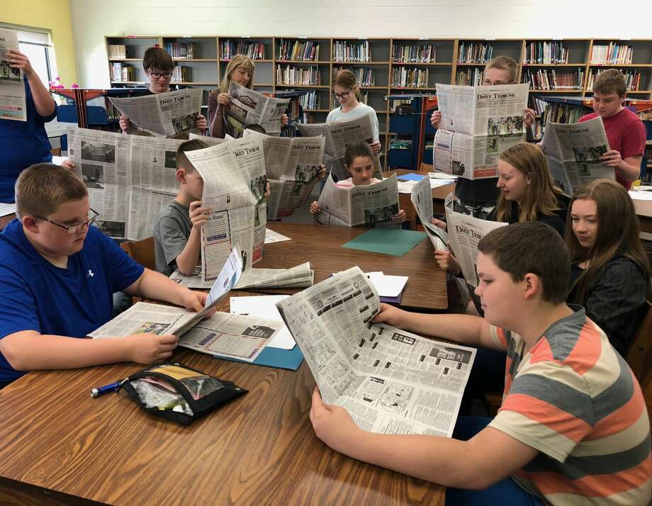 Sixth and seventh graders check out the Huron Daily Tribune, following a guest appearance from Editor Kate Hessling, who spoke with one of Doreen Paganini's classes on Wednesday morning about working in journalism. Photo: Kate Hessling/Huron Daily Tribune