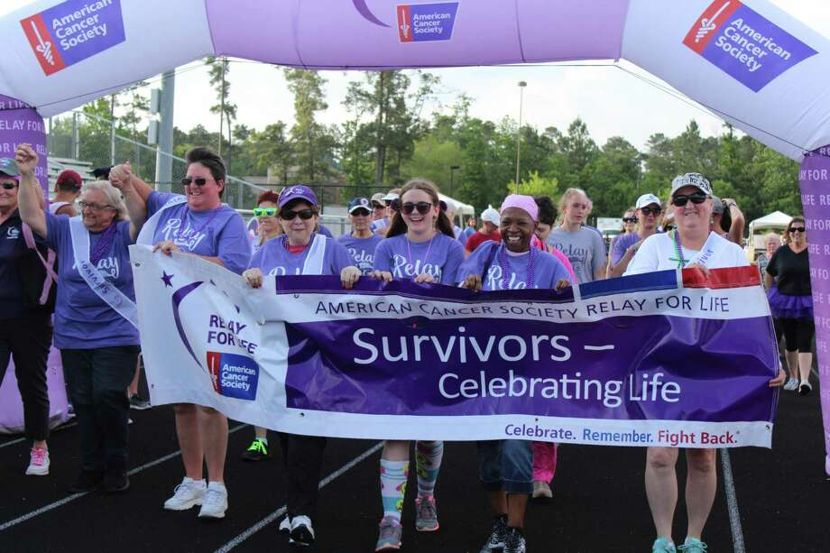 Cancer survivors walk during the Survivors Lap at the 2018 Relay for Life The Woodlands at College Park High School on Friday, May 11, 2018. Photo: Patricia Dillon / The Woodlands Villager