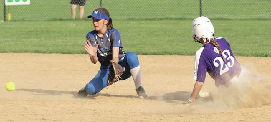 Marquette Catholic shortstop Haley Johnson (left) takes a throw too late to put a tag on Collinsville's Hannah Scrum, who slides win with a stolen base during an Explorers win May 2 at Moore Park in Alton. The Explorers were in Wood River on Friday and beat the EA-WR Oilers to improve to 31-1. Photo:       Greg Shashack / The Telegraph