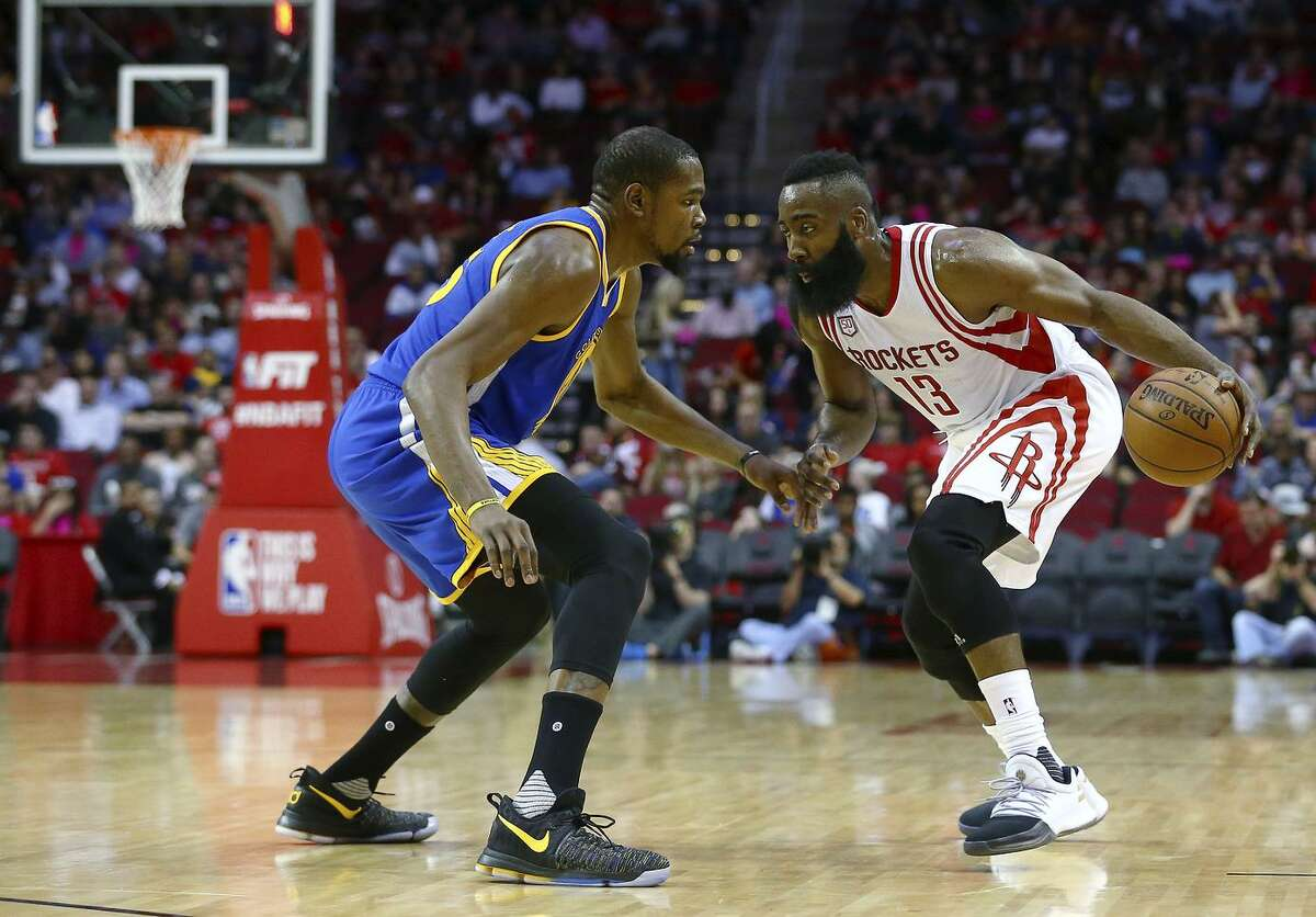 Houston Rockets guard James Harden (13) is defended by Golden State Warriors forward Kevin Durant (35) during the second quarter of an NBA game on Jan. 20, 2017 in Houston.