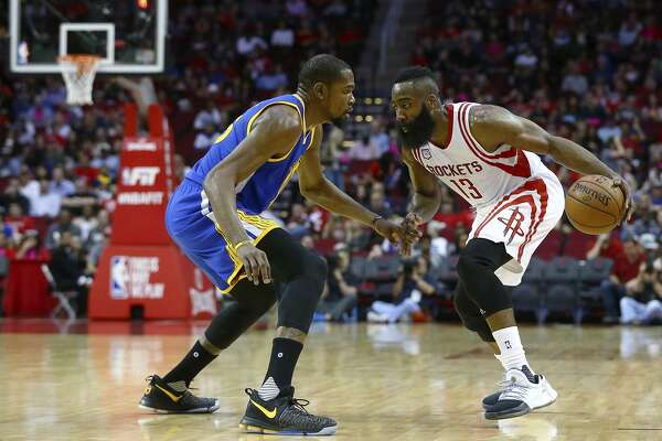 202a5faeeae 1of10Houston Rockets guard James Harden (13) is defended by Golden State  Warriors forward Kevin Durant (35) during the second quarter of an NBA game  on Jan.