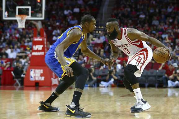 Kevin Durant tries to slow the Rockets' James Harden in a 2017 game in Houston. Harden scored 17 points that January night, 15 fewer than Durant in Golden State's 17-point win.