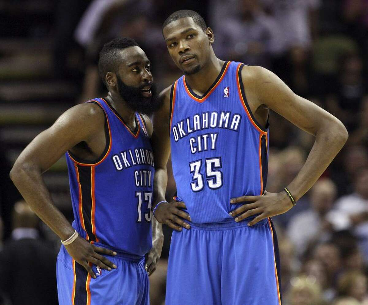 James Harden (13) talks with Kevin Durant (35) during the first half of game two of the NBA Western Conference Finals in San Antonio, Texas on May 29, 2012.