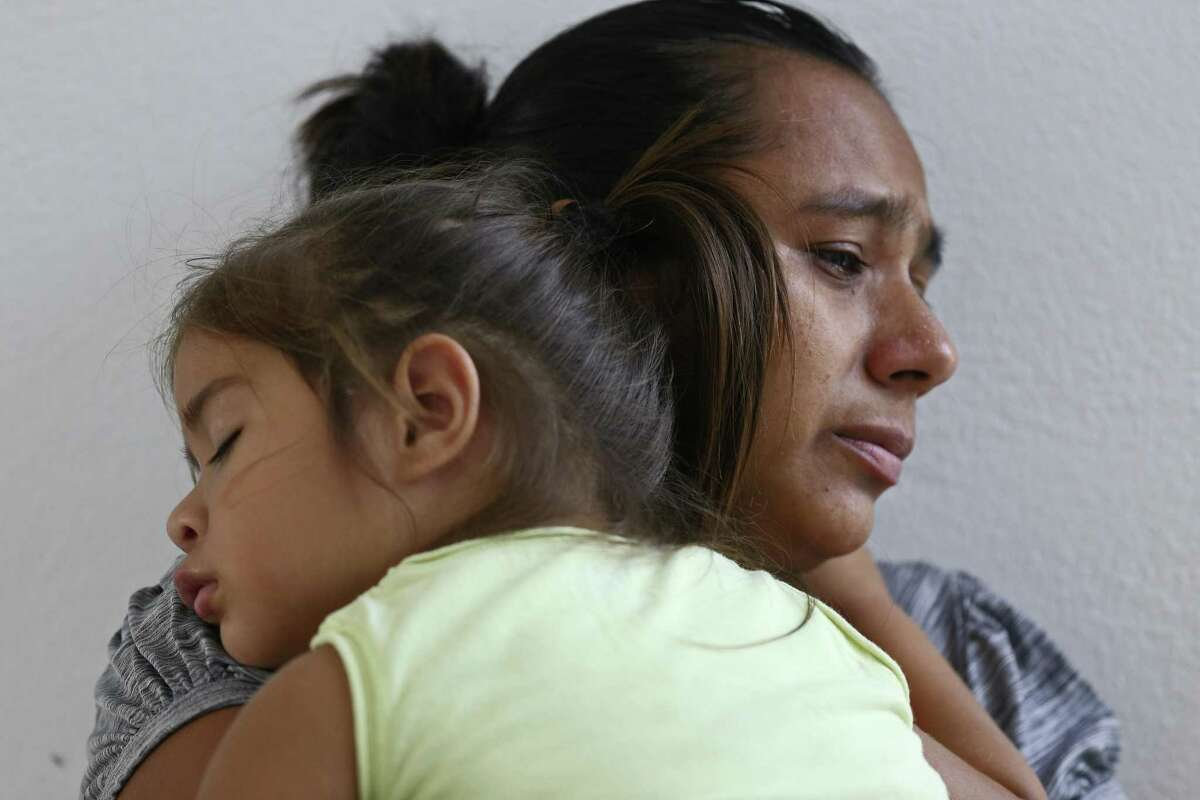 Teresa Rosa, 40, of Honduras holds her daughter, Berta, 2, at a shelter in Reynosa, Mexico.