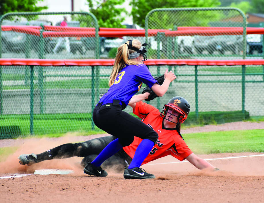 Edwardsville's Anna Burke slides safely into third base ahead of the tag from Kate Griffith during Saturday morning's non-conference game inside the District 7 Sports Complex.