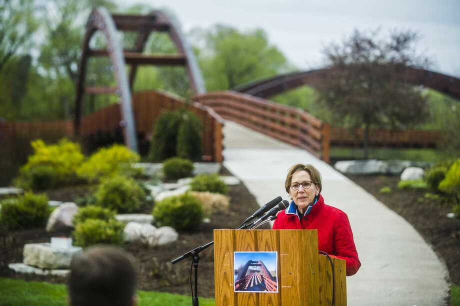 Mayor Maureen Donker speaks during a rededication ceremony for the Tridge on Saturday, May 12, 2018 in Chippewassee Park. (Katy Kildee/kkildee@mdn.net) Photo: (Katy Kildee/kkildee@mdn.net)