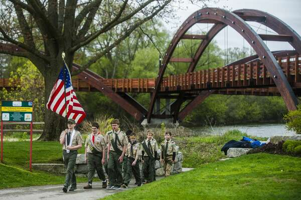 Boy Scout Troop 768 performs the presentation of colors during a rededication ceremony for the Tridge on Saturday, May 12, 2018 in Chippewassee Park. (Katy Kildee/kkildee@mdn.net)