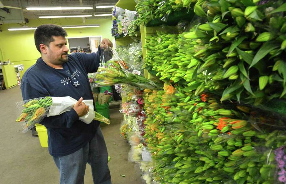 Jamal Ansari, Owner at East Coast Wholesale Flowers grabs some bouquets for an order on Tuesday  in Norwalk . Photo: Alex Von Kleydorff / Hearst Connecticut Media / Norwalk Hour