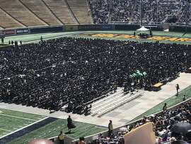 Students held up signs in protest at UC Berkeley commencement Saturday.