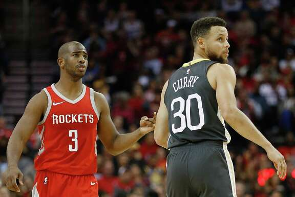 HOUSTON, TX - JANUARY 20:   Chris Paul #3 of the Houston Rockets and Stephen Curry #30 of the Golden State Warriors at Toyota Center on January 20, 2018 in Houston, Texas. NOTE TO USER: User expressly acknowledges and agrees that, by downloading and or using this photograph, User is consenting to the terms and conditions of the Getty Images License Agreement.  (Photo by Bob Levey/Getty Images)