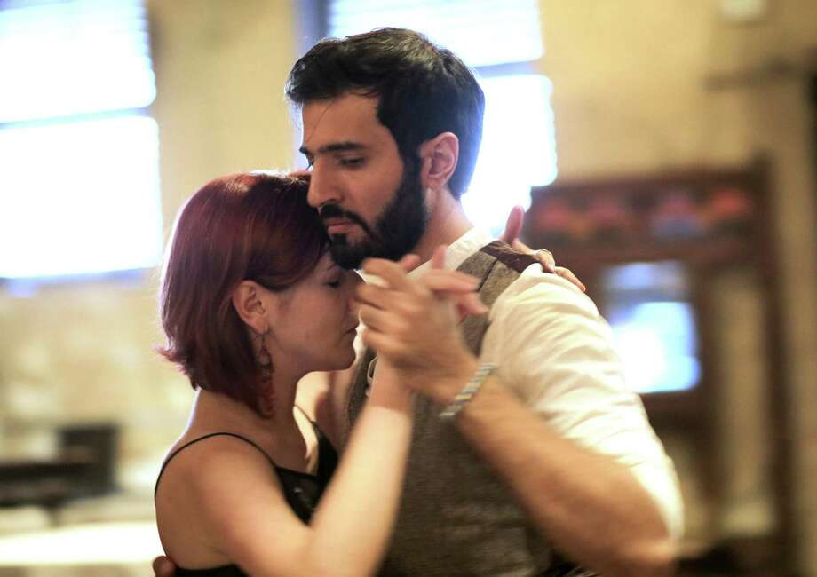 Ahmed Abdulmajeed dances the tango with Iryan Ilyk at Nouveau Antique Art Bar in downtown Houston on Wednesday, May 10, 2018. Houston Tango will be hosting a teaching and dancing fundraiser on Thursday, May 17, 2018 for PAIR Houston. ( Elizabeth Conley / Houston Chronicle ) Photo: Elizabeth Conley, Chronicle / Houston Chronicle / © 2018 Houston Chronicle