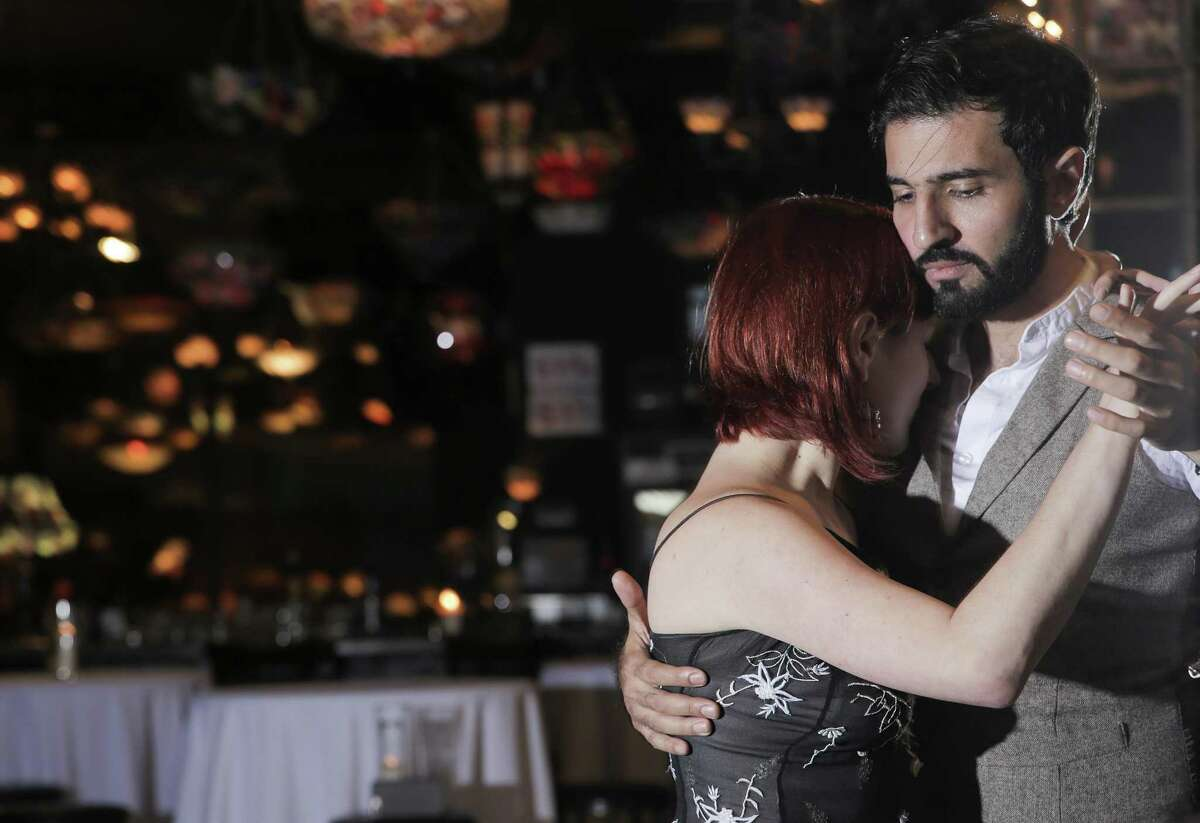 Ahmed Abdulmajeed dances the tango with Iryan Ilyk at Nouveau Antique Art Bar in downtown Houston on Wednesday, May 10, 2018. Houston Tango will be hosting a teaching and dancing fundraiser on Thursday, May 17, 2018 for PAIR Houston. ( Elizabeth Conley / Houston Chronicle )