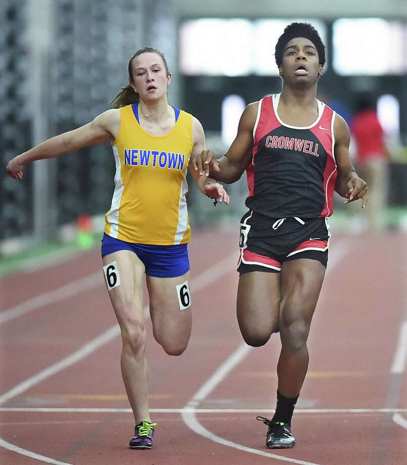 Cromwell's Andraya Yearwood, right, competes against Newtown's Carly Swierbut in the 55-meter dash at the CIAC Indoor Track and Field State Open on Feb. 17 in New Haven. Photo: Catherine Avalone / Hearst Connecticut Media / New Haven Register