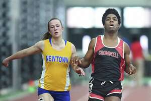 Cromwell's Andraya Yearwood, right, competes against Newtown's Carly Swierbut in the 55-meter dash at the CIAC Indoor Track and Field State Open on Feb. 17 in New Haven.