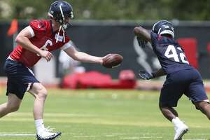 The Houston Texans rookies quarterback Tyler Stehling and running back Terry Swanson work on a training drill at the 2018 Houston Texans Rookie Minicamp on Saturday, May 12, 2018, in Houston. ( Yi-Chin Lee / Houston Chronicle )