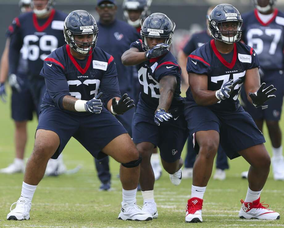 The Houston Texans rookie players K.J. Malone, from left, Terry Swanson and Martinas Rankin go through a drill during training at the 2018 Houston Texans Rookie Minicamp on Saturday, May 12, 2018, in Houston. ( Yi-Chin Lee / Houston Chronicle ) Photo: Yi-Chin Lee/Houston Chronicle