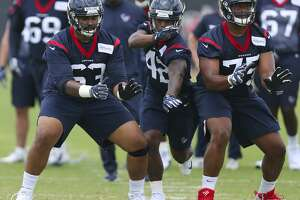 The Houston Texans rookie players K.J. Malone, from left, Terry Swanson and Martinas Rankin go through a drill during training at the 2018 Houston Texans Rookie Minicamp on Saturday, May 12, 2018, in Houston. ( Yi-Chin Lee / Houston Chronicle )