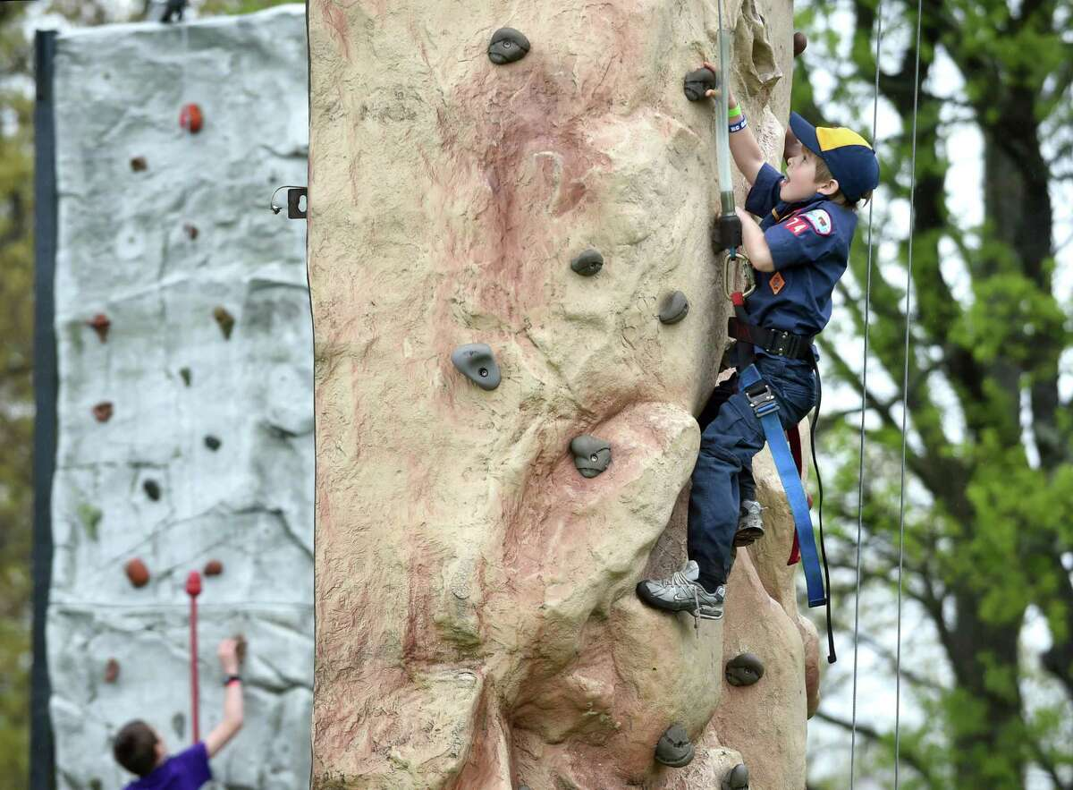 Liam Scheck, 7, of Stratford nears the top of a rock climbing wall during ConnJam 2018 hosted by the Boy Scouts of America, Connecticut Yankee Council, at the Orange Fairgrounds on May 12, 2018.