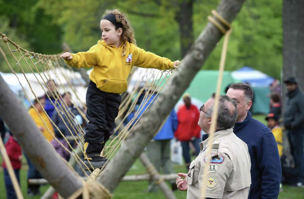 Amelia Loffredo, 4, of Branford climbs across the monkey bridge built by Boy Scout Troop 11 of Stamford during ConnJam 2018 hosted by the Boy Scouts of America, Connecticut Yankee Council, at the Orange Fairgrounds on May 12, 2018.