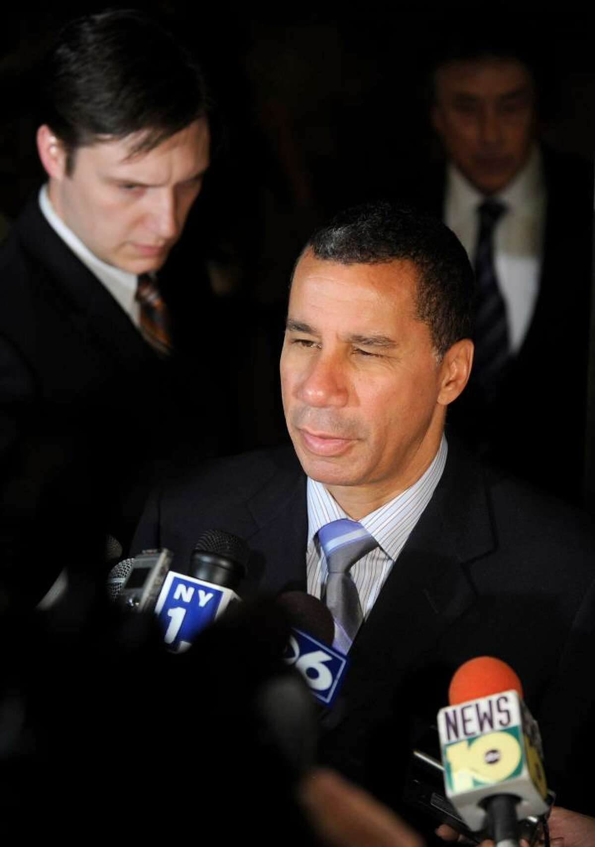 Gov. David Paterson says he has been busy with vetoes, but has signed two bills this week affecting the lives of ordinary New Yorkers. (AP Photo/Tim Roske)