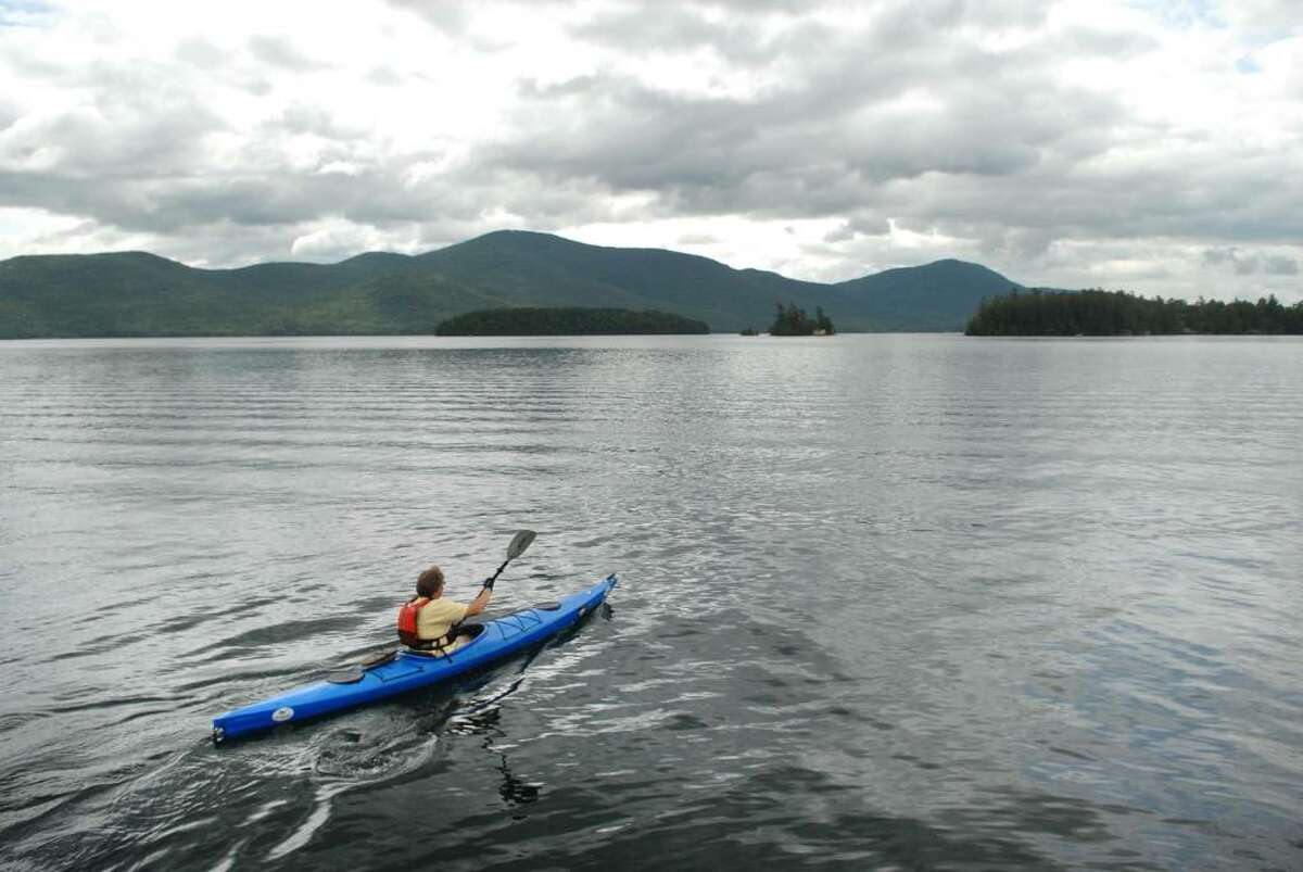 Chris Navitsky, the Lake George Waterkeeper, paddles out on Lake George. Though some authorities say paddlers should avoid going to far into the lake, Navitsky and others enjoy making a trip across or watching a sunset from the middle of the lake. (Paul Buckowski / Times Union)