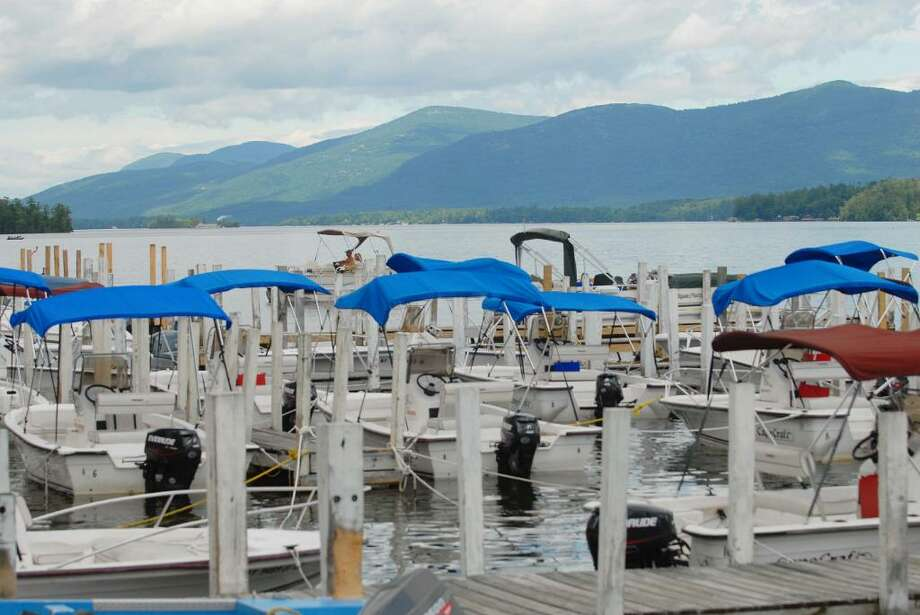 Motorized boats are seen docked in the southern end on Lake George. Motorboats, excursion boats, kayaks and canoe users are among the boaters using the largest lake within the Adirondacks.  (Paul Buckowski / Times Union) Photo: PAUL BUCKOWSKI / 00009222A