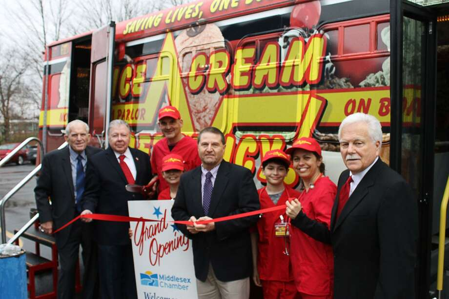 Ice Cream Emergency Central CT Territory held a Grand Opening on April 19 in Middletown. Ice Cream Emergency is a uniquely themed, full-service mobile ice cream parlor available for rentals. From left to right is Chamber President Larry McHugh, Vice Chairman Jay Polke, scoopologists Mike Natanzon and Maura Natanzon and their family, Chamber Chairman Rick Morin and Middletown Small Business Development Counselor Paul Dodge. Photo: Courtesy Of Middlesex Chamber