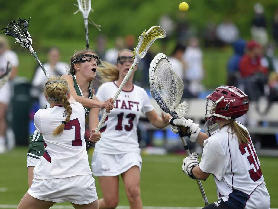 Sacred Heart's Lillian DeConcini (10)drives through Taft defenders to fire in a score against goalie Lily Cook (31) during an FAA girls lacrosse game at Sacred Heart Greenwich Sheehan Turf Field on May 12, 2018 in Greenwich, Connecticut. Sacred Heart won 18-3. Photo: Matthew Brown / Hearst Connecticut Media / Stamford Advocate