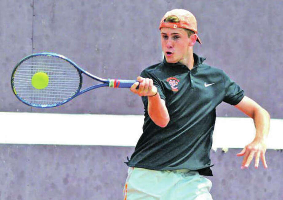 Edwardsville senior Alex Gray hits a shot during the Southwestern Conference Tournament on Saturday at Belleville West. Gray won the No. 1 singles title and the Tigers rolled to their 18th successive SWC championship. Photo:       Scott Marion / Hearst Newspapers
