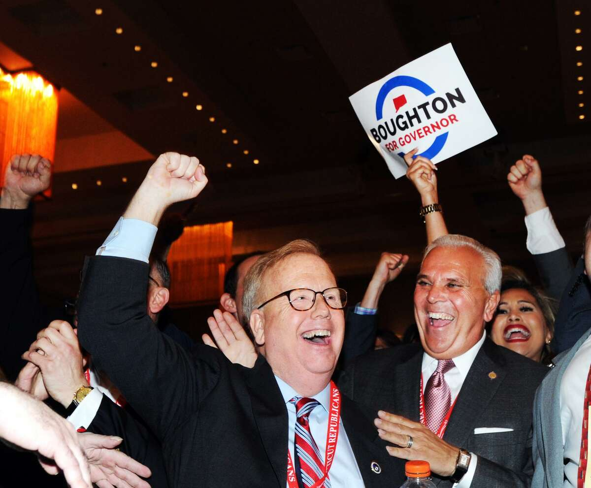 Danbury Mayor Mark Boughton, center, pulled out an apparent third-round victory Saturday at the Republican State Convention at Foxwoods Casino in Mashantucket, giving him the nominal GOP endorsememt for governor.