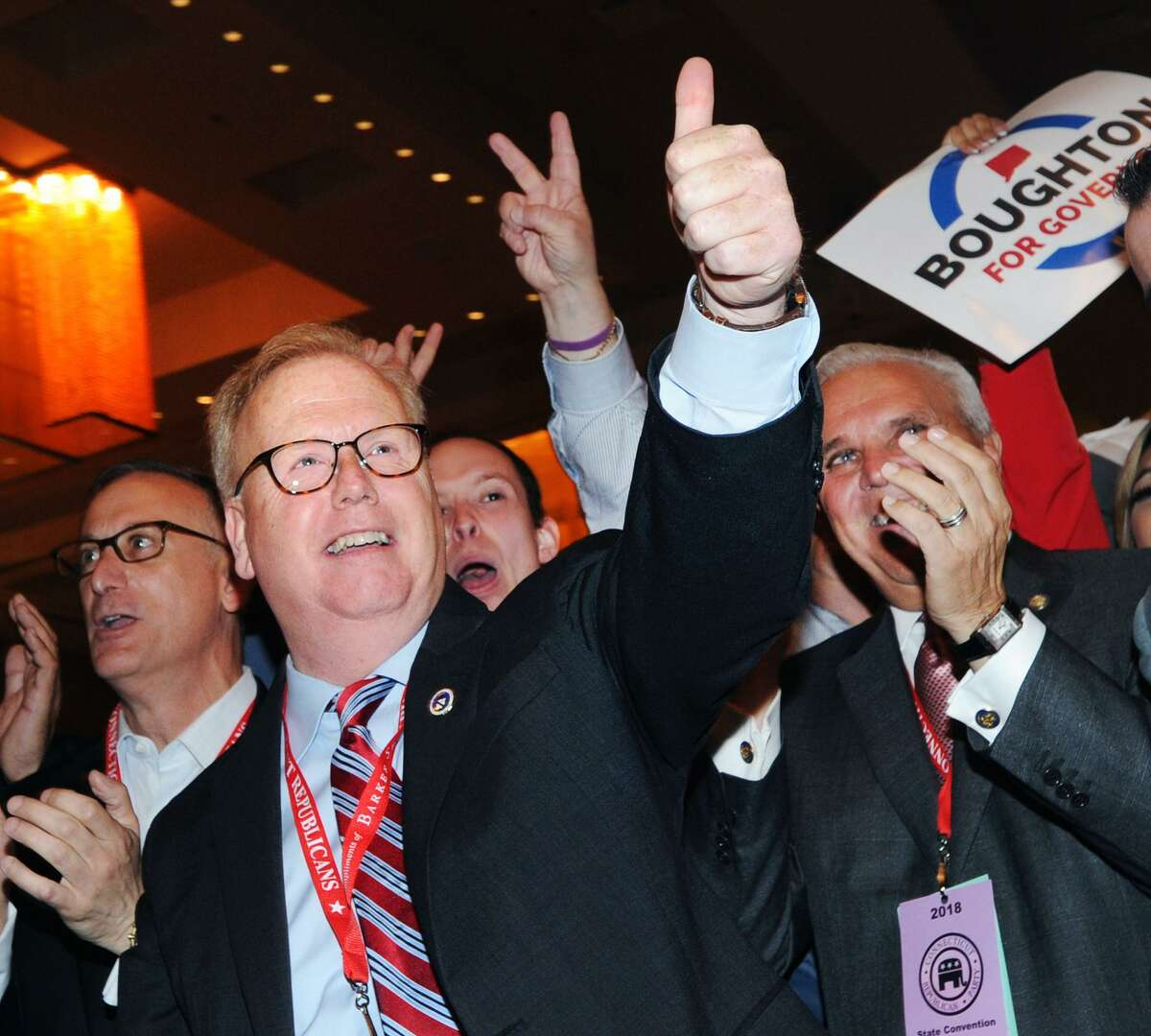 Danbury Mayor Mark Boughton, center, reacts after surpassing 50% of the delegate votes, enough needed to win the unofficial nomination as the Republican candidate for Governor during the Republican State Convention at Foxwoods Casino, Mashantucket, Conn., Saturday, May 12, 2018.