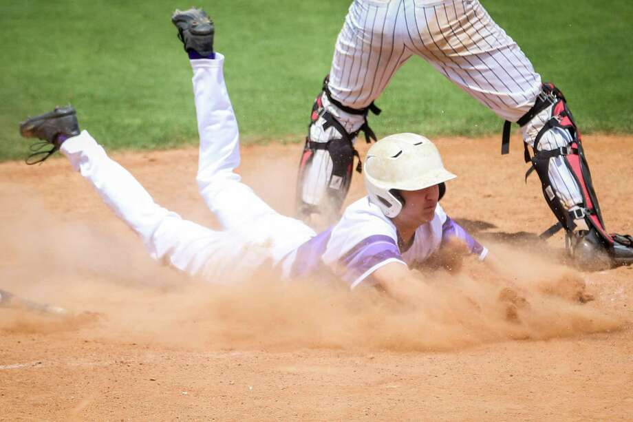 Montgomery's Grayson Iund (1) slides into home base off of a sacrifice fly by Triston Whitehead (20) during the baseball game against Coppell on Saturday, May 12, 2018, at Montgomery High School. (Michael Minasi / Houston Chronicle) Photo: Michael Minasi, Staff Photographer / © 2018 Houston Chronicle