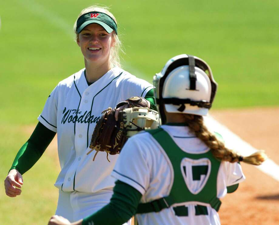 The Woodlands relief pitcher Amanda Curran (22) smiles toward catcher Jordan Neely (17) aftergetting Mckayla Chamberlain #2 of Deer Park to line out to second base during the fifth inning of a non-district high school softball game at The Woodlands High School, Wednesday, March 14, 2018, in The Woodlands. Photo: Jason Fochtman, Staff Photographer / © 2018 Houston Chronicle