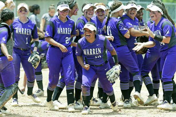 Warren teammates watch third baseman Lauryn Hernandez  (10) lead the celebration after Warren beats O'Connor in class 6A third round softball playoff action at Northside ISD Complex No. 2 on May 12, 2018.