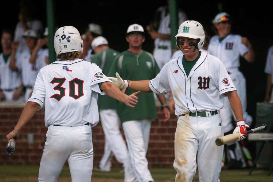 The Woodlands' Matthew Bulovas (30) celebrates with Casey Sunseri (3) during the baseball game against Sachse on Friday, May 11, 2018, at Scotland Yards. (Michael Minasi / Houston Chronicle) Photo: Michael Minasi, Staff Photographer / © 2018 Houston Chronicle