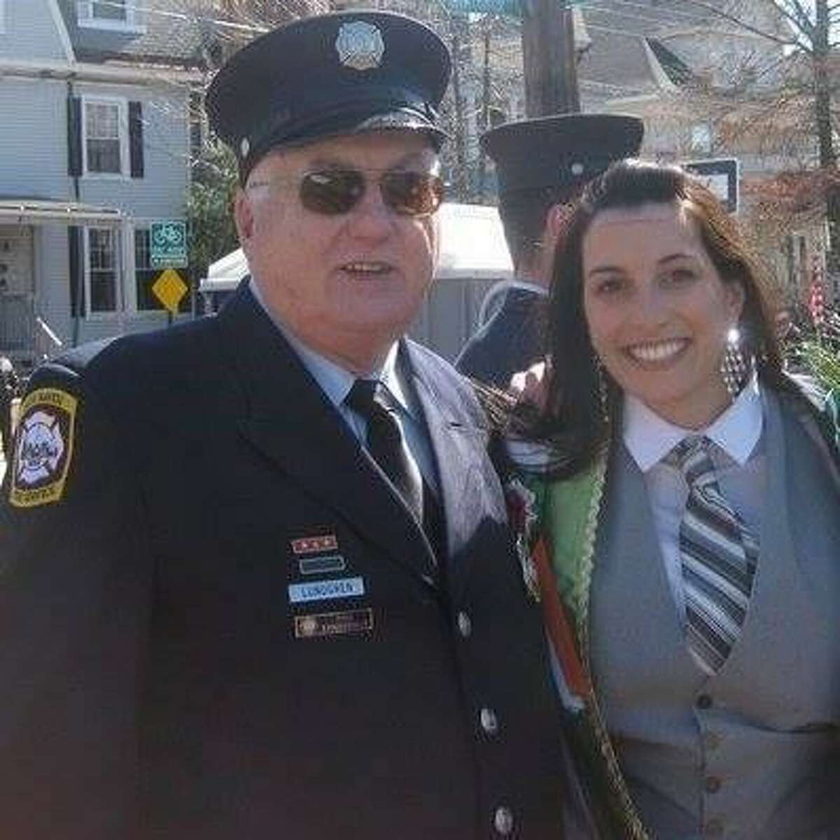 Parade Committee member Courtney Lundgren Connors and her father Martin Lundgren with the New Haven Fire Department marching together in the Greater New Haven St. Patrick's Day Parade.