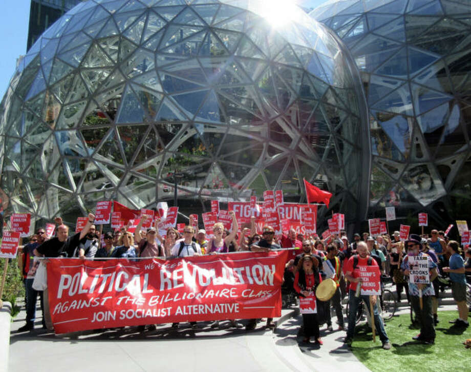 Housing advocates call for a Seattle 'head tax' in front of Amazon's iconic Spheres. Photo: GeekWire Photos / Monica Nickelsburg