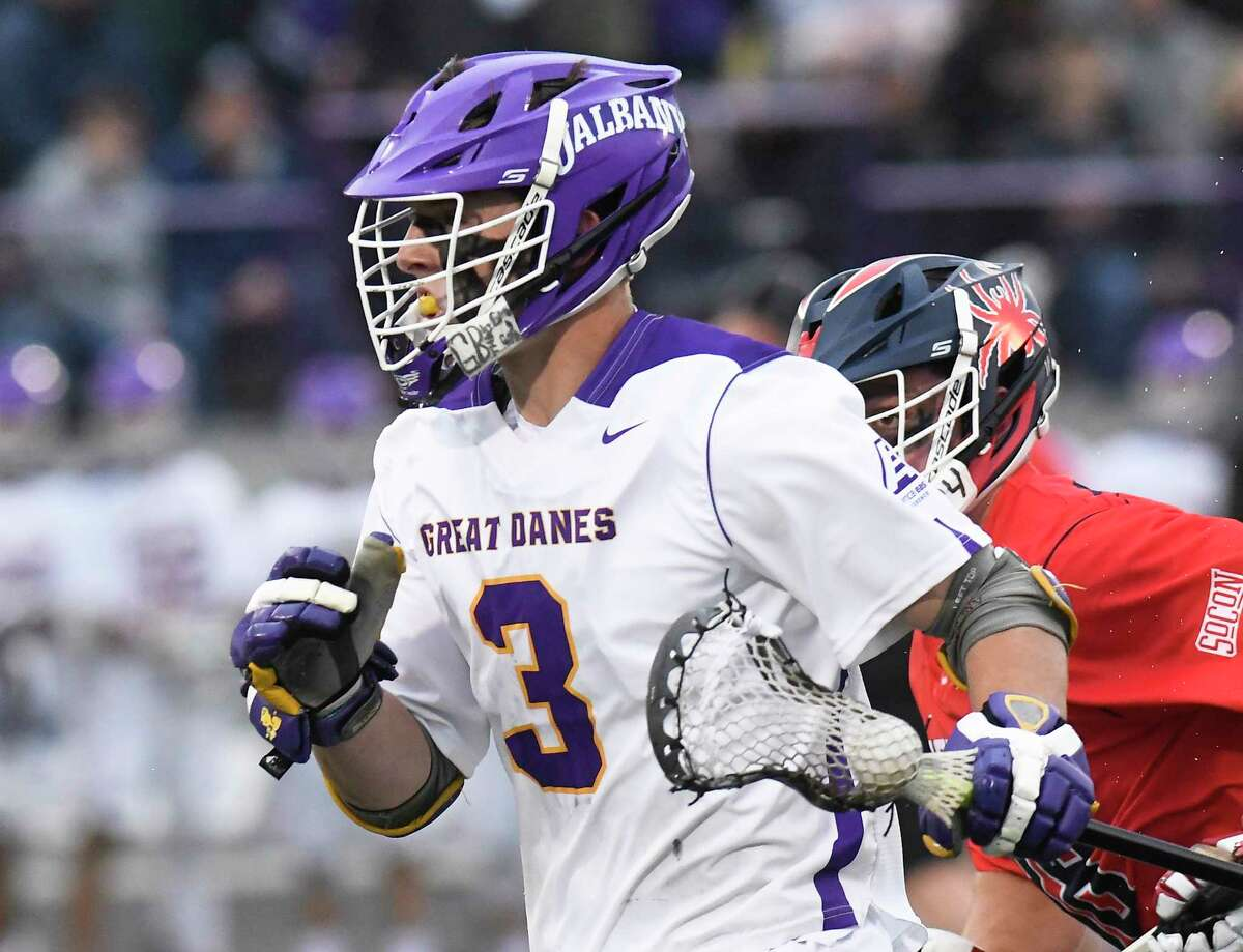 UAlbany's TD Ierlan (3) runs with the ball against Richmond during a NCAA Tournament first-round Division I lacrosse game Saturday, May 12, 2018, in Albany, N.Y.