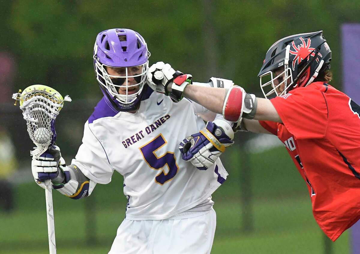 UAlbany's Connor Fields (5) is defended by Richmond?•s Austin Cates (12) during a NCAA Tournament first-round Division I lacrosse game Saturday, May 12, 2018, in Albany, N.Y.