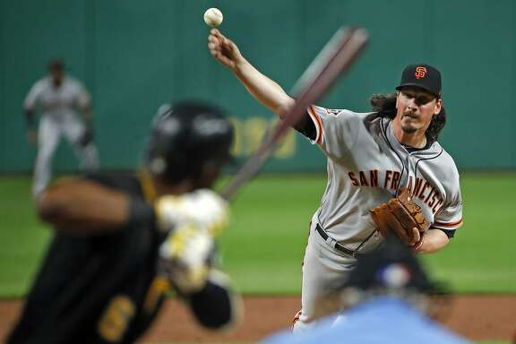 San Francisco Giants starting pitcher Jeff Samardzija delivers to Pittsburgh Pirates' Starling Marte (6) in the first inning of a baseball game in Pittsburgh, Saturday, May 12, 2018. (AP Photo/Gene J. Puskar)