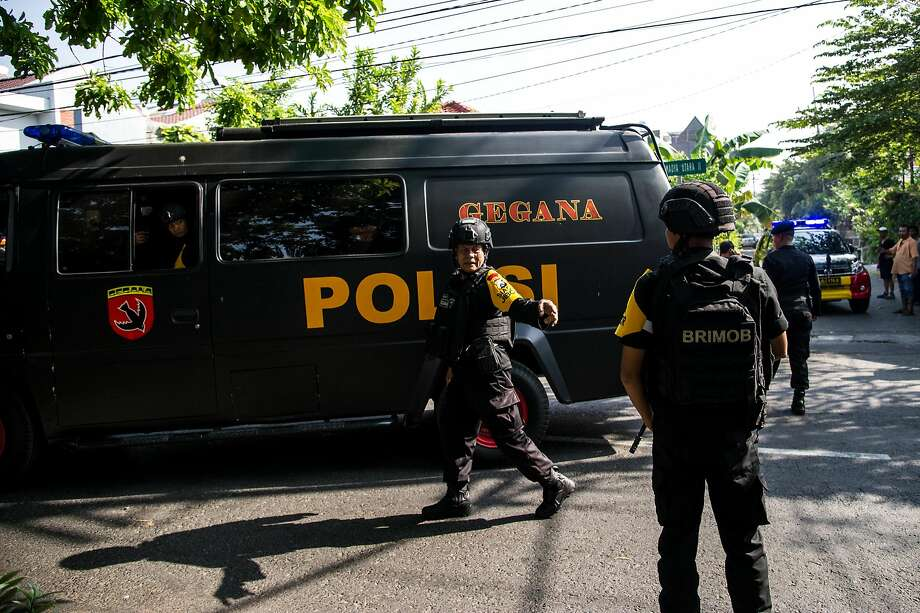Indonesian policemen patrol outside a church following a suicide bomb in Surabaya on May 13, 2018. At least two people were killed and 13 others injured in bomb attacks, including a suicide blast, targeting churches in Indonesia's second biggest city Surabaya, police said. Photo: JUNI KRISWANTO, AFP/Getty Images