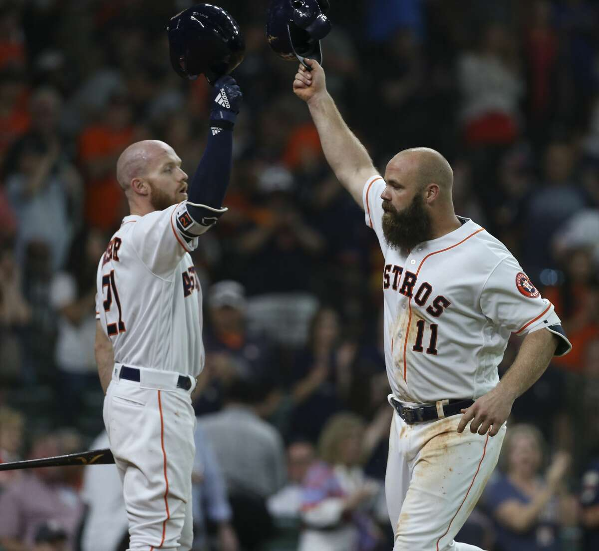 Houston Astros catcher Evan Gattis (11) and Derek Fisher (21) touch helmets to celebrate Gattis' home run during the bottom fifth inning of the MLB game at Minute Maid Park on Saturday, May 12, 2018, in Houston. ( Yi-Chin Lee / Houston Chronicle )