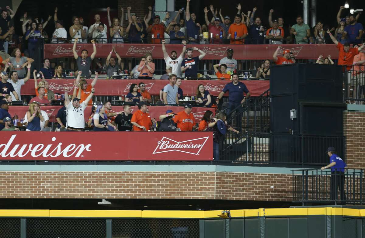 Houston Astros fans cheer for Houston Carlos Correa's two-run home run going over the wall during the eighth inning of the MLB game against the Texas Rangers at Minute Maid Park on Saturday, May 12, 2018, in Houston. ( Yi-Chin Lee / Houston Chronicle )