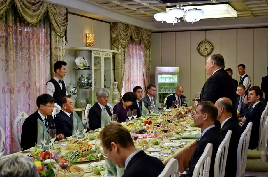 Secretary of State Mike Pompeo, right, stands as he speaks during a dinner between North Korean dignitaries and US diplomats, Pyonyang, North Korea on Wednesday, May 9, 2018. It began with quiet words from State Department officials: Apply for a new passport immediately. You may soon be going to a country for which ordinary U.S. passports are not valid for travel.  (AP Photo/Matthew Lee, Pool) Photo: Matthew Lee / Copyright 2018 The Associated Press. All rights reserved.