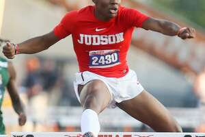 Judson's Tre'Bien Gilbert looks to the stadium scoreboard as he clears the last hurdle in the 6A boys 300-meter hurdles during the second day of the UIL state track and field championships at Mike A. Myers Stadium in Austin on Saturday, May 12, 2018.   Gilbert won the event with a city record 36.18 seconds.  MARVIN PFEIFFER/mpfeiffer@express-news.net