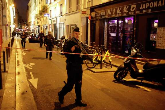 A police officer cordons off the area after a knife attack in central Paris, Saturday May 12, 2018. The Paris police said the attacker was subdued by officers during the stabbing attack in the 2nd arrondissement or district of the French capital Saturday. (AP Photo/Thibault Camus)