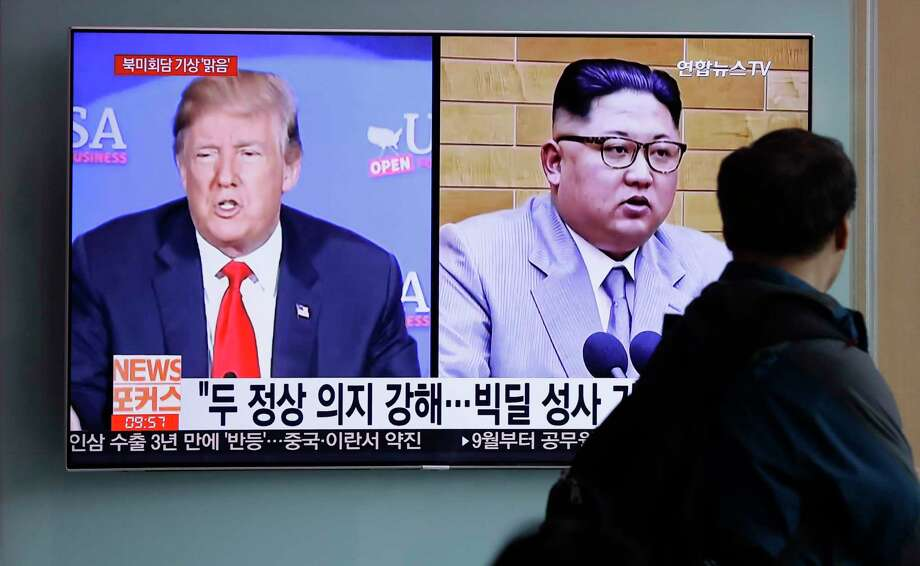 """FILE - In this May 11, 2018, file photo, a man watches a TV screen showing file footage of U.S. President Donald Trump, left, and North Korean leader Kim Jong Un with onscreen letters reading """"Summit between U.S. and North Korea, Forecast, Clear."""" during a news program at the Seoul Railway Station in Seoul, South Korea.  North Korea's Foreign Ministry said Saturday May 12, 2018, it will hold a """"ceremony"""" for the dismantling of its nuclear test site on May 23-25 in what would be a dramatic but symbolic event to set up the summit meeting between Kim Jong Un and US President Donald Trump scheduled for next month.(AP Photo/Lee Jin-man) Photo: Lee Jin-man / Copyright 2018 The Associated Press. All rights reserved."""