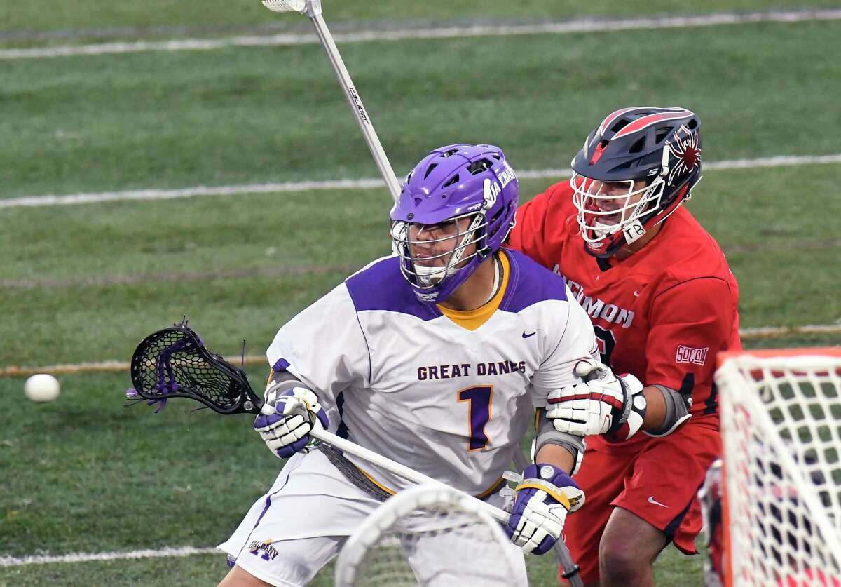 UAlbany's Tehoka Nanticoke (1) receives a pass from a teammate in front of Richmond's RichmondOs Tyler Shoults (18) during a NCAA Tournament first-round Division 1 lacrosse game Saturday, May 12, 2018, in Albany, N.Y. (Hans Pennink / Special to the Times Union)