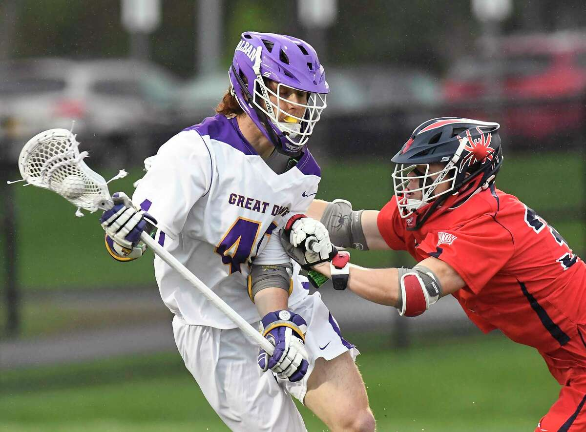 UAlbany's Kyle McClancy (40) moves the ball against Richmond's Anthony Faraino (37) during an NCAA Tournament first-round lacrosse game in 2018. McClancy has signed with the Albany FireWolves of the National Lacrosse League.